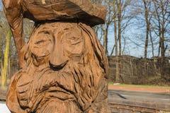 Drewniana postać rzeźbiąca z łańcuszkowym saw Zdjęcie Stock