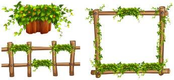 Drewniana rama i ogrodzenie z roślinami Obrazy Stock