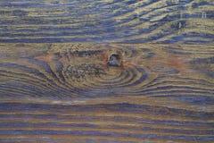Drewniana tekstura taktująca z heban plamą i złocistą farbą zdjęcia royalty free
