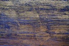 Drewniana tekstura taktująca z heban plamą i złocistą farbą zdjęcie stock