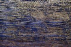 Drewniana tekstura taktująca z heban plamą i złocistą farbą obrazy royalty free
