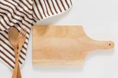 Drewniana tnąca deska i rozwidlenie Fotografia Stock