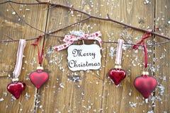 Drewniane gałąź z bożych narodzeń ornamentami i cukierkiem Obraz Stock