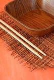 Drewniani chopsticks i puchar Obraz Stock