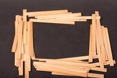 Drewniani kije na czarnym tle fotografia royalty free