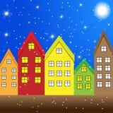 Drewniani kolorowi budynki na opóźnionym jesień wieczór Zdjęcie Royalty Free