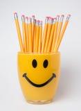 Drewniani ołówki w smiley filiżance zdjęcia royalty free