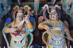 Drewniani opiekuny przy bramą Bulguksa świątynia Fotografia Royalty Free
