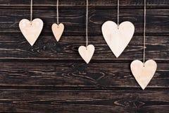 Drewniani serca na drewnianym tle Obraz Royalty Free