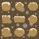 Drewniani signboards wewnątrz differen kształty z roztapiającym śniegiem Fotografia Royalty Free
