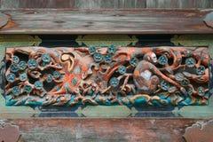Drewniany cyzelowanie na storehouse przy Nikko, Toshogu świątynia w Japonia Obrazy Royalty Free
