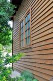 Drewniany dom i okno fotografia royalty free