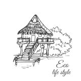 Drewniany dom na wodzie z pokrywającym strzechą dachem i długi schody w stylu nakreślenia Zdjęcia Stock