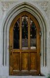 Drewniany drzwi w Kamiennym Archway Zdjęcie Stock