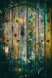 Drewniany drzwi zakrywający w farb pluśnięciach Zdjęcia Royalty Free