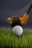 Kij golfowy i piłka Obrazy Royalty Free
