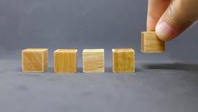 Drewniany kubiczny z rzędu zdjęcie royalty free