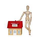 Drewniany mannequin i dom Zdjęcia Stock