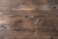 Drewniany nieociosany brown tło Obrazy Stock