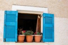 Drewniany okno z błękitnymi żaluzjami Obrazy Royalty Free