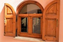 Drewniany okno z dwa żaluzjami Fotografia Stock