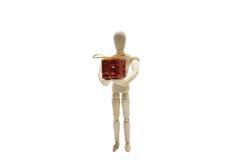 Drewniany postaci lali i czerwień prezenta pudełko na białym backgound zdjęcia stock
