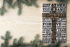 Drewniany rzeźbiący słowo władyki modlitwa na podławej drewnianej desce z jedlinowym gałąź tłem zdjęcie royalty free