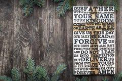 Drewniany rzeźbiący słowo władyki modlitwa na starej wietrzejącej drewnianej desce z jedlinowym gałąź tłem zdjęcie royalty free