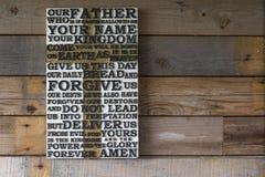 Drewniany rzeźbiący słowo władyki ` s modlitwa na podławym drewnianym p obraz royalty free