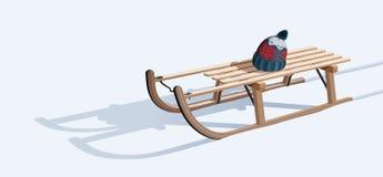 Drewniany sanie i kapelusz na śniegu Zdjęcia Stock