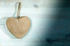 Drewniany serce na błękit desce Obraz Royalty Free