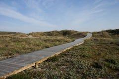 Drewniany spacer w hiszpańszczyzny plaży Obrazy Stock