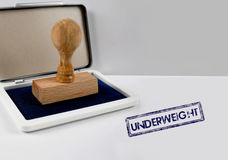 Drewniany stemplowy UNDERWEIGHT Obraz Royalty Free