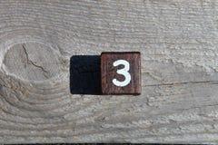 Drewniany sześcian z numerowi trzy Zdjęcia Stock