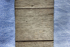 Drewniany tło na niebiescy dżinsy teksturze Obraz Royalty Free