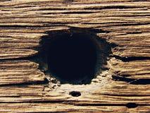 Drewniany tło z dziurą Zdjęcia Royalty Free