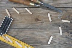 Drewniany tło z małymi częściami Obrazy Royalty Free