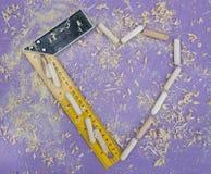 Drewniany tło z małymi metal częściami Zdjęcia Stock