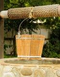 Drewniany Well wiadro Zdjęcie Royalty Free