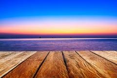 Drewniany z zmierzchu wieczór w morzu Fotografia Stock
