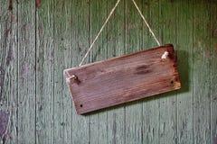 Drewniany znak na wathered stajni ścianie Obraz Stock