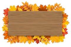 Drewniany znak z jesieni klonowego drzewa liśćmi Obrazy Stock