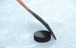 Dribbling. Ice hockey stick and a puck Stock Photography