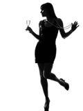 dricka festa silhouettekvinna för champagne Royaltyfria Bilder