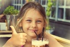 dricka flicka little Royaltyfria Foton