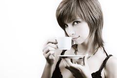 dricka kvinnabarn för kaffe arkivbild