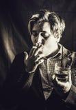 dricka rökning Arkivbild