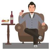 Dricka rött vin för ung man Arkivfoto