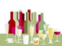 Dricker exponeringsglas och flaskor Arkivfoto