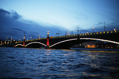 The dridge over the river. Bridge over a calm river Royalty Free Stock Images